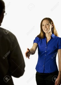 5444939-A-business-woman-holding-her-hand-out-to-shake-with-a-business-man-Banque-d'images